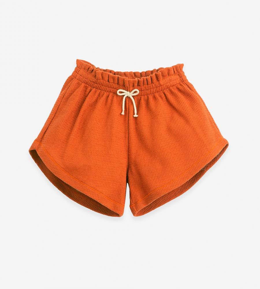 Pantalón corto de punto de algodón orgánico en color Anise
